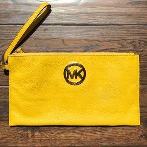 Michael Kors large yellow wristlet gold hardware